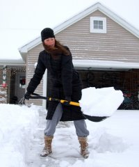 Woman-shoveling-snow