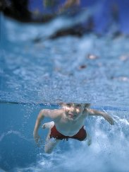 Little-boy-swimming-underwater